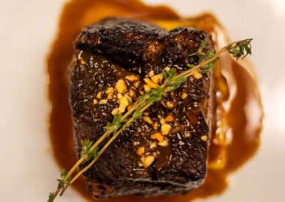 Costoline, a nutella braised short rib with hazelnut dusting on polenta